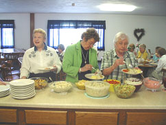 Volunteers enjoying potluck